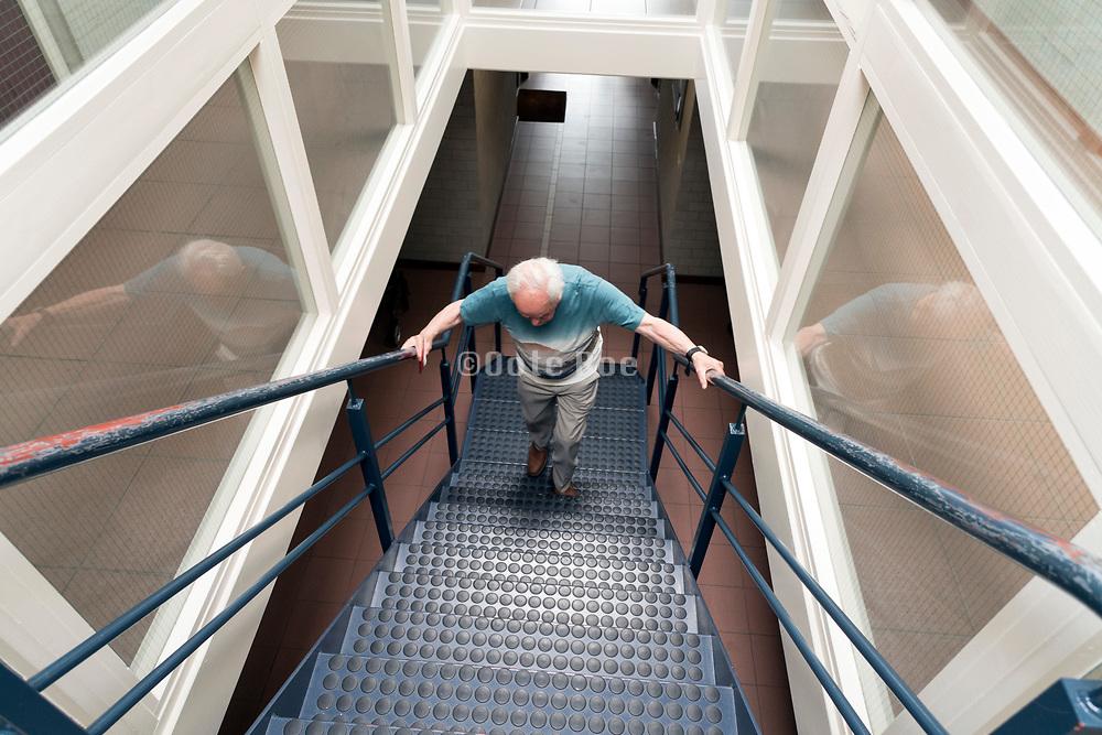 senior man walking up the stairs