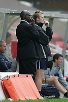 Photo: Lee Earle.<br /> Swindon Town v Port Vale. Coca Cola League 1. 08/10/2005. Swindon manager Iffy Onuora (L) and Alan Reeves watch the game.