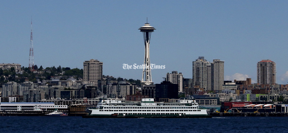 The ferry Hyak and the Space Needle seen from Harbor Island. (Alan Berner / The Seattle Times)