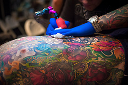 @Licensed to London News Pictures 27/05/2017. London, UK. Customers getting tattooed in London today. More than 300 of the world's finest tattoo artist attend The Great British Tattoo Show in Alexandra Palace in London today. Photo credit: Manu Palomeque/LNP