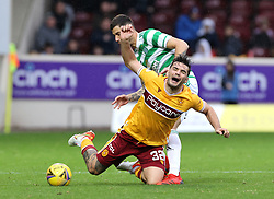 Motherwell's Tony Watt goes down after a foul by Celtic's Nir Bitton during the cinch Premiership match at Fir Park, Motherwell. Picture date: Saturday October 16, 2021.