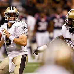 August 21, 2010; New Orleans, LA, USA; New Orleans Saints quarterback Drew Brees (9) looks to pass during the first quarter of a preseason game at the Louisiana Superdome. Mandatory Credit: Derick E. Hingle