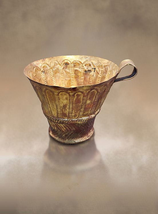 Mycenaean gold cup with arches decoration, Grave V, Grave Circle A Mycenae, Greece. National Archaeological Museum of Athens.<br /> <br /> An elegant precious gold cup hammered from thick gold to created a simple elegant design. This Mycenaean gold cup demonstrates how advance Mycenaean metalworking was in the 16th century BC. The value of the cup would have been extermely high so must have graced the table of a Mycenaean noble perhaps even a v king. .<br /> <br /> If you prefer to buy from our ALAMY PHOTO LIBRARY  Collection visit : https://www.alamy.com/portfolio/paul-williams-funkystock/mycenaean-art-artefacts.html . Type -   Athens    - into the LOWER SEARCH WITHIN GALLERY box. Refine search by adding background colour, place, museum etc<br /> <br /> Visit our MYCENAEN ART PHOTO COLLECTIONS for more photos to download  as wall art prints https://funkystock.photoshelter.com/gallery-collection/Pictures-Images-of-Ancient-Mycenaean-Art-Artefacts-Archaeology-Sites/C0000xRC5WLQcbhQ