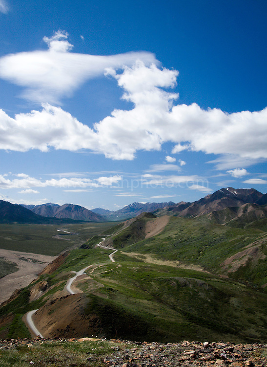 View of Polychrome Mountain, Denali National Park, Alaska. The road is the only one in Denali - a tortuous 90 mile road that winds alongside mountain cliffs.