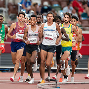 TOKYO, JAPAN August 3:  Grant Fisher of the United States, Justyn Knight of Canada and Luis Grijalva of Guatemala set the early pace during the Men's 5000m round one heat two race at the Olympic Stadium during the Tokyo 2020 Summer Olympic Games on August 3rd, 2021 in Tokyo, Japan. (Photo by Tim Clayton/Corbis via Getty Images)