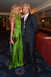 NICKY CLARKE and KELLY SIMPKIN at the Caudwell Children's annual Butterfly Ball held at The Grosvenor House Hotel, Park Lane, London on 15th May 2014.