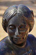 close up details of a bronze Sculpture of a woman's head and face at the Ralli Museum in Caesarea, Israel.