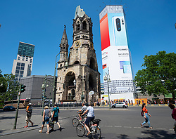 Large billboard for Huawei on church in Berlin, Germany