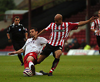 Photo: Tony Oudot.<br /> Brentford v Lincoln City. Coca Cola League 2. 27/10/2007.<br /> Lee Thorpe of Brentford is tackled by Jamie Hand of Lincoln