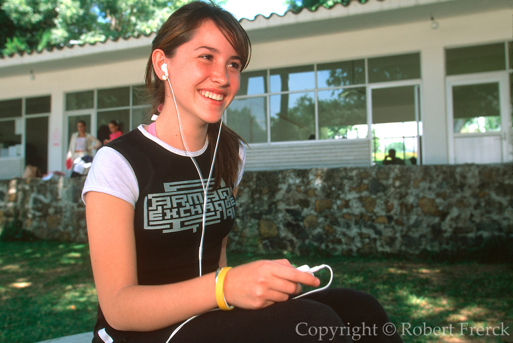 MEXICO, EDUCATION portrait of a highschool student listening to music on the campus of Centro Educativo in Cocoyoc near Cuernavaca