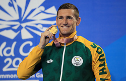 South Africa's Cameron Van Der Burgh with his Gold medal in the Men's 50m Breaststroke at the Gold Coast Aquatic Centre during day five of the 2018 Commonwealth Games in the Gold Coast, Australia.