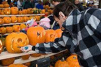 Lighting Jack o Lanterns at Keene Pumpkin Festival