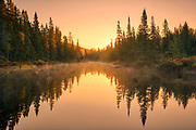 Dawn light reflects in a waterway that will eventually empty into Lake Superior.<br />Lake Superior Provincial Park<br />Ontario<br />Canada