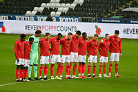 Football - 2020 / 2021 Sky Bet Championship - Swansea City vs Rotherham United - Liberty Stadium<br /> Rotherham team line up for minutes silence <br /> in a match played without fans<br /> <br /> COLORSPORT/WINSTON BYNORTH