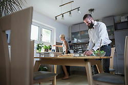 Young couple preparing food in the kitchen, Bavaria, Germany