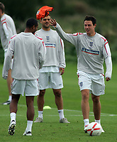 Photo: Paul Thomas.<br /> England training at Carrington. 30/08/2006. <br /> <br /> Wayne Bridge throws a training bib to Ashley Cole (L).
