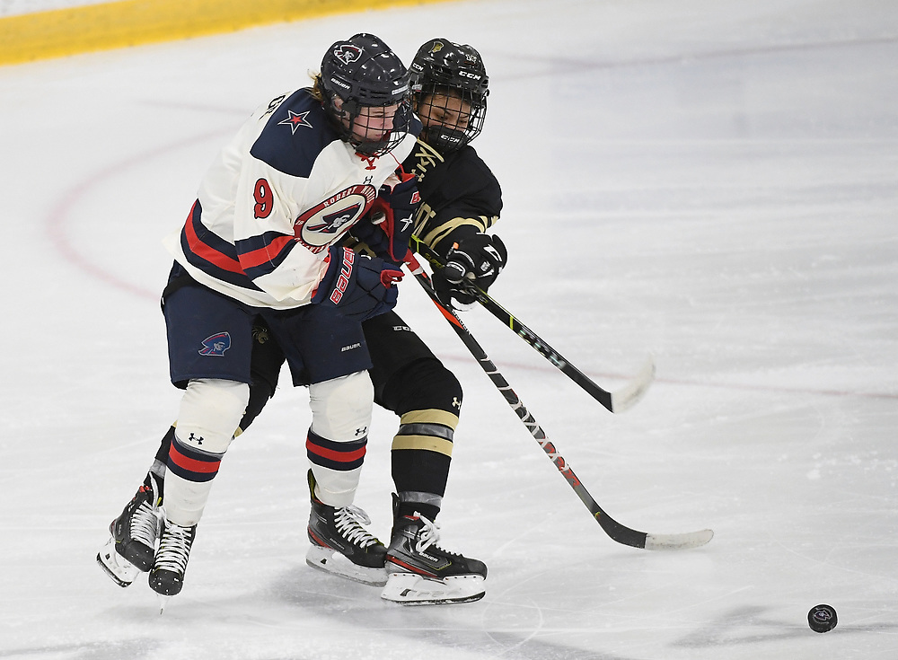 PITTSBURGH, PA - DECEMBER 04: Maggy Burbidge #9 of Robert Morris Colonials battles for a loose puck with Teagan Heaslip #18 of Lindenwood Lions in the second period during the game at Clearview Arena on December 4, 2020 in Pittsburgh, Pennsylvania. (Photo by Justin Berl)