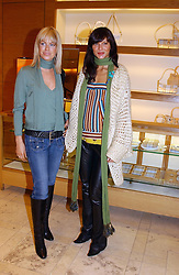 Left to right, CAROLINE HABIB and ULIA MUNSTERMANN at a party hosted by Burberry to launch their special collection in aid of Breakthrough Breast Cancer, held at 21-23 New Bond Street, London W1 on 5th October 2004.<br /><br />NON EXCLUSIVE - WORLD RIGHTS