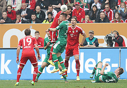 05.04.2014, SGL Arena, Augsburg, GER, 1. FBL, FC Augsburg vs FC Bayern Muenchen, 29. Runde, im Bild l-r: Mario Goetze #19 (FC Bayern Muenchen), im Zweikampf, Aktion, Kopfballduell mit Mario Mandzukic #9 (FC Bayern Muenchen) und Ronny Philp #3 (FC Augsburg), Daniel Van Buyten #5 (FC Bayern Muenchen), Jan-Ingwer Callsen-Bracker #18 (FC Augsburg) // during the German Bundesliga 29th round match between FC Augsburg and FC Bayern Munich at the SGL Arena in Augsburg, Germany on 2014/04/05. EXPA Pictures © 2014, PhotoCredit: EXPA/ Eibner-Pressefoto/ Kolbert<br /> <br /> *****ATTENTION - OUT of GER*****