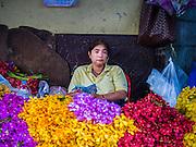 21 OCTOBER 2014 - BANGKOK, THAILAND:  A vendor on a street corner sells cut flowers in the Pak Khlong Talat market on the Chao Phraya River in Bangkok.   PHOTO BY JACK KURTZ