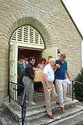 Family carrying grandma in handmade wood coffin age 30 through 80.  Cambria Wisconsin USA