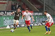 Fussball: 2. Bundesliga, FC St. Pauli - Hamburger SV, Hamburg, 01.03.2021<br /> Finn Ole Becker (Pauli, l.) - Moritz Heyer (HSV)<br /> © Torsten Helmke