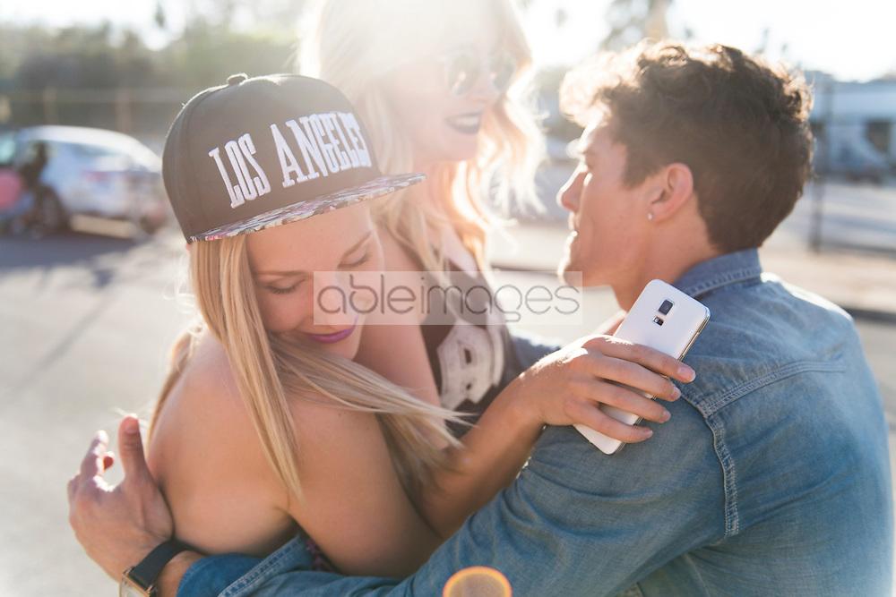 Friends Hugging on Street