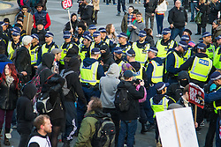 """London, April 16th 2016. Police move in on a small group of protesters dancing in Trafalgar Square after thousands of people supported by trade unions and other rights organisations demonstrated against the policies of the Tory government, including austerity and perceived favouring of """"the rich"""" over """"the poor""""."""