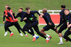 England's John Stones (centre) during the training session at St Georges' Park, Burton. PRESS ASSOCIATION Photo. Picture date: Monday September 10, 2018. See PA story SOCCER England. Photo credit should read: Mike Egerton/PA Wire. RESTRICTIONS: Use subject to FA restrictions. Editorial use only. Commercial use only with prior written consent of the FA. No editing except cropping.