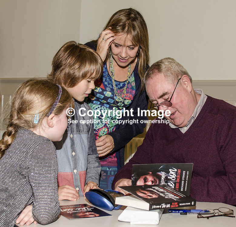 Book launch of In the Name of the Son: The Gerry Conlon Story at the Crescent Arts Centre, Belfast, N Ireland, UK. Richard O'Rawe, the book's author, signs a copy for a mum and two children. 6th October 2017, 201710064678<br /> <br /> Copyright Image from Victor Patterson, Belfast, UK<br /> <br /> t: +44 28 9066 1296 (from Rep of Ireland 048 9066 1296)<br /> m: +44 7802 353836<br /> e: victorpattersonbelfast@gmail.com<br /> <br /> www.images4media.com<br /> <br /> Please see my full Terms and Conditions of Use at https://www.images4media.com/p/terms-conditions - it is IMPORTANT that you familiarise yourself with them.<br /> <br /> Images used online incur an additional cost. This cost should be agreed in writing in advance. Online images must be visibly watermarked i.e. © Victor Patterson or that of the named photographer within the body of the image. The original metadata must not be deleted from images used online.<br /> <br /> This image is only available for the use of the download recipient i.e. television station, newspaper, magazine, book publisher, etc, and must not be passed on to a third party. It is also downloaded on condition that each and every usage is notified within 7 days to victorpattersonbelfast@gmail.com.<br /> <br /> The right of Victor Patterson (or the named photographer) to be identified as the author is asserted in accordance with The Copyright Designs And Patents Act (1988). All moral rights are asserted.