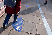 On the day that the UK has recorded 50,000 Covid cases, the first time in three months, only one half of a torn pavement social distancing sticker remains on Blackfriars Bridge, a sign that the public appear to have already forgotten about the Covid pandemic, on 21st October 2021, in London, England.
