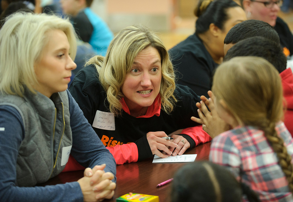 Amazon associate Nicole Puz interacts with children during a trivia game as over one hundred students participate in Amazon's Rise & Smile campaign breakfast event Nov. 9, 2018, at McAdoo Kelayres Elementary/Middle School in Hazleton, Pennsylvania. Amazon has partnered with Share Our Strength's No Kid Hungry campaign to help bring healthy breakfast to students across the country. (Photo by Matt Smith)