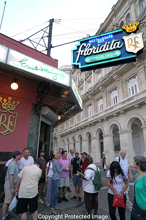 Havana, Cuba, 2019/01/14.  El Floridita bar in Havana, Cuba . A statue of Hemingway in foreground with a photograph of Hemmingway and Castro  on the wall in the background., Photograph by Dennis Brack