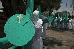 April 13, 2017 - Temascancingo, Estado De Mexico, MEXICO - With more than 100 years of tradition, the Brotherhood of Cruciferos, founded in 1902 enact the traditional walk on the streets in the municipality of Temascalcingo, Estado de Mexico on Thursday, April 13, 2017. More than 150 men of all ages carry the cross as penance, petition or for blessings received during Eastern weekend. ANTONIO NAVA/PI (Credit Image: © Prensa Internacional via ZUMA Wire)