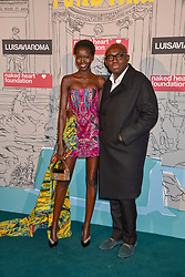 Edward Enninful and Adut Akech at the Fabulous Fund Fair in aid of Natalia Vodianova's Naked Heart Foundation in association with Luisaviaroma held at The Round House, Camden, London England. 18 February 2019.