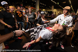 Lolo doing the Limbo at the Sultans of Sprint party during the Intermot International Motorcycle Fair. Cologne, Germany. Saturday October 6, 2018. Photography ©2018 Michael Lichter.