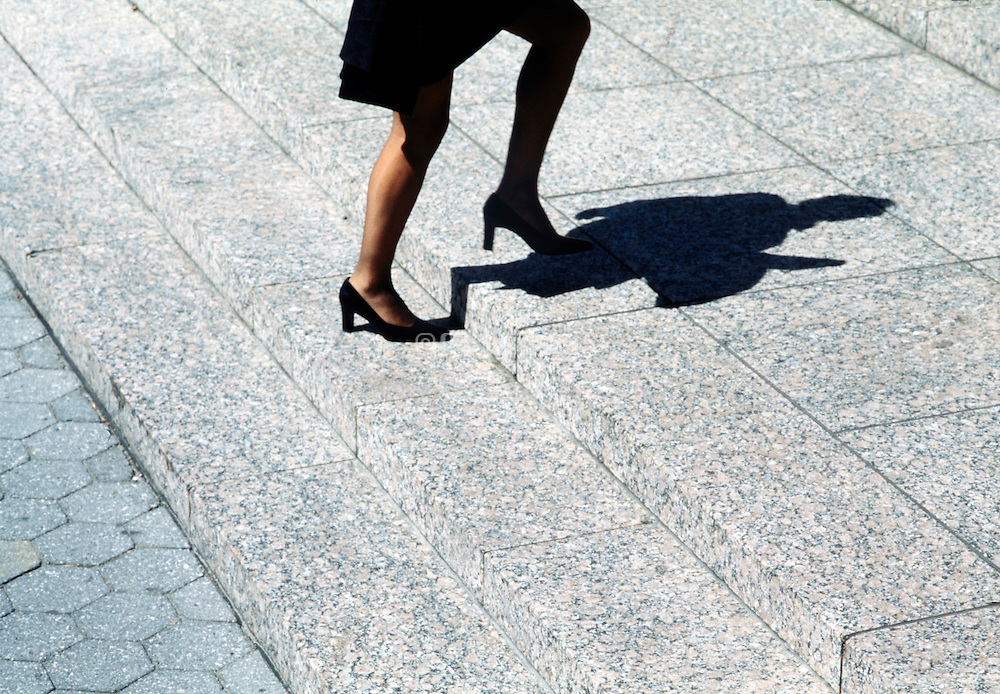 female person walking up some steps