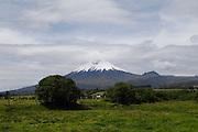 Ecuador, May 26 2010: View of Volcano Cotapaxi from the grounds of Hacienda San Agustin del Callo. Copyright 2010 Peter Horrell