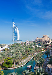 View across Al Qasr hotel towards Burj Al Arab Hotel in Midnat Jumeirah in Dubai in United Arab Emirates