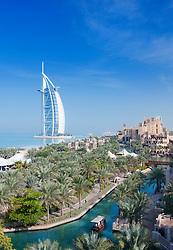View across Al Qasr hotel towards Burj Al Arab Hotel in Midnat Jumeirah in Dubai in United Arab Emirates