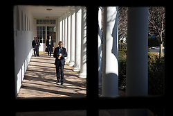 President Barack Obama looks at his watch as he walks along the Colonnade to the Oval Office, March 2, 2015. (Official White House by Chuck Kennedy)<br /> <br /> This official White House photograph is being made available only for publication by news organizations and/or for personal use printing by the subject(s) of the photograph. The photograph may not be manipulated in any way and may not be used in commercial or political materials, advertisements, emails, products, promotions that in any way suggests approval or endorsement of the President, the First Family, or the White House.