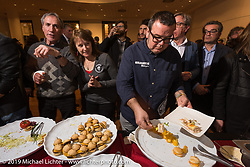 Great food at Motor Bike Expo's gala opening party at the Palazzo Della Gran Guardia the night before the show opening. Verona, Italy. Thursday January 18, 2018. Photography ©2018 Michael Lichter.