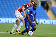 Junior Hoilett of Cardiff city ® is challenged by Chris Basham of Sheffield United .. EFL Skybet championship match, Cardiff city v Sheffield Utd at the Cardiff City Stadium in Cardiff, South Wales on Tuesday 15th August 2017.<br /> pic by Andrew Orchard, Andrew Orchard sports photography.