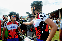 PAARL SOUTH AFRICA - MARCH 23: Women's Africa Jersey winners Amy Beth and Candice Lill congratulate eachother on their podium result for the 70km final day, stage 7 on March 23, 2018 Wellingtion to Paarl, South Africa. Mountain bikers gather from around the world to compete in the 2018 ABSA Cape Epic, racing 8 days and 658km across the Western Cape with an accumulated 13 530m of climbing ascent, often referred to as the 'untamed race' the Cape Epic is said to be the toughest mountain bike event in the world. (Photo by Dino Lloyd)