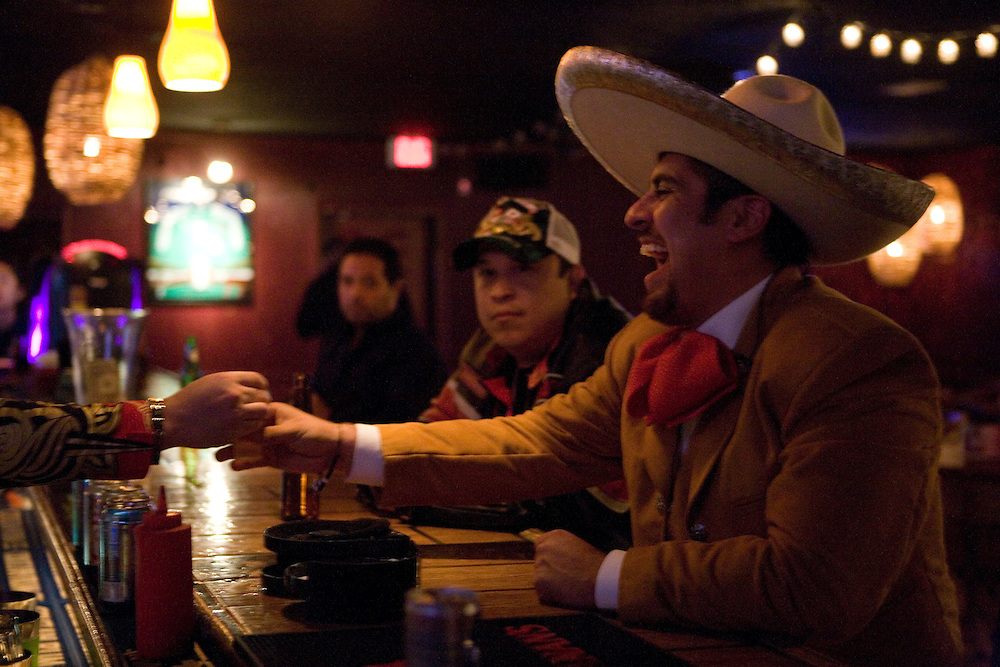 Mariachi musician Walterio Magdaleno has a shot of tequila before preforming at Bar 33 on Saturday night, Oct. 10, 2009..