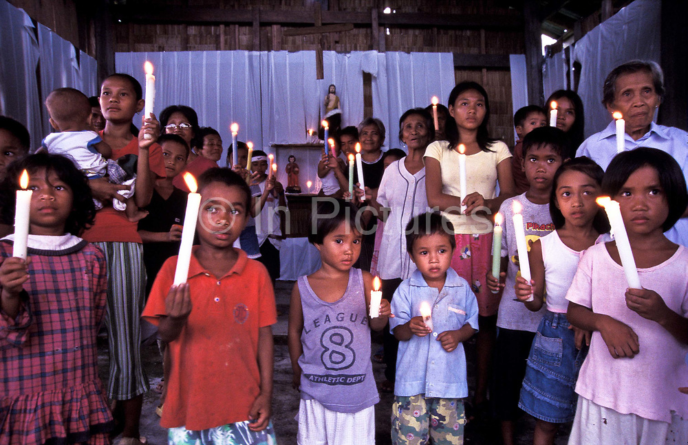 Villagers celebrate mass to honour St. George day, the patron saint of Busok Busok village, Aurora province, Philippines