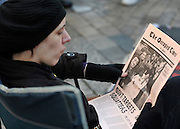 © Licensed to London News Pictures. 17/11/2011, London, UK. A protester reads a copy of 'The Occupied Times' a newspaper made by the protesters. Occupy London tents outside St Paul's Cathedral today 17 November 2011.  Photo credit : Stephen Simpson/LNP