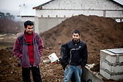 Emil (20) and Michal (22) at the recontruction side in their village Rankovce where they joined a micro loan program to built themselves their own house. Support by the foundation ETP Slovakia which is working in Rankovce and setting up micro-loan funds for the local Roma community.