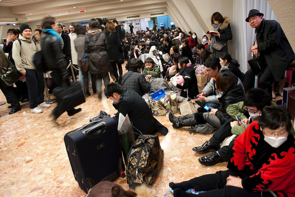 People in a hotel lobby. Shinagawa, Tokyo, 11 March 2011. After a huge earthquake in north-east Japan several million people in Tokyo struggle to return home.