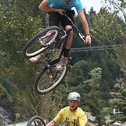 Andre Loo, 20, (top) from Queenstown, and Ben Tyas from Auckland in action during the Gorge Road Mega Jam, for BMX and Mountain Bike riders to mark the opening  of the Gorge Road Jump Park run by the Queenstown Mountain Bike Club,  Queenstown, New Zealand. 3rd December 2011. Photo Tim Clayton
